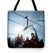 A Skier And Snowboarder Share The Chair Tote Bag