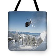A Skier Doing A Front Flip Into Powder Tote Bag