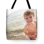 A Smiling Young Boy Enjoys A Sunny Tote Bag