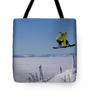 A Snowboarder Catches Air Off A Jump Tote Bag