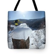 A Snowboarder Jumps Off A Cliff Tote Bag