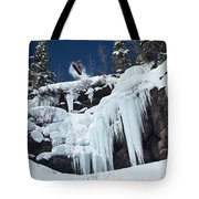 A Snowboarder Jumps Off An Ice Tote Bag