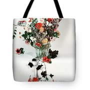 A Studio Shot Of A Vase Of Flowers And A Garden Tote Bag