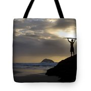 A Surfer On Muriwai Beach New Zealand Tote Bag