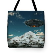A Ufo Flying Over A Mountain Range Tote Bag