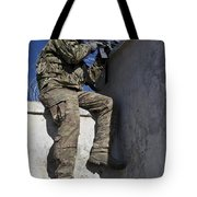 A U.s. Soldier Provides Security At An Tote Bag