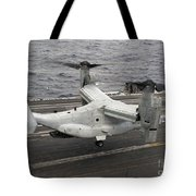 A V-22 Osprey Lands Aboard The Aircraft Tote Bag