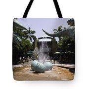 A Water Fountain With Dinosaur Eggs And Dinsosaurs In Universal Studios Tote Bag