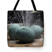A Water Fountain With Dinosaur Eggs In The Universal Studios Singapore Tote Bag