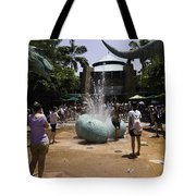 A Water Fountain With Dinosaur Eggs In Universal Studios Singapore Tote Bag