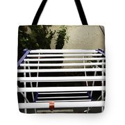 A White Plastic Stand For Hanging And Drying Clothes Tote Bag