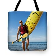 A Woman Carrying Her Sea Kayak Tote Bag