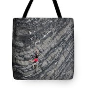 A Woman Climbs Above Her Protection Tote Bag