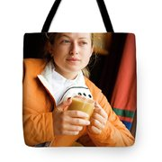 A Woman Enjoys A Warm Cup Of Cocoa Tote Bag