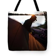 A Woman Exits The Tent At Sunset Tote Bag
