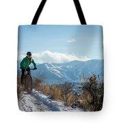 A Woman Fat Biking On The Trails Tote Bag