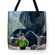 A Woman Hiking High In The Mountains Tote Bag