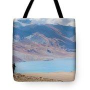 A Woman Is Hiking Toward Tsomoriri Tote Bag