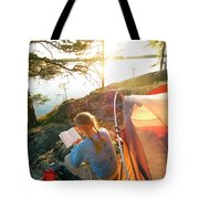 A Woman Is Resting In A Tent On One Tote Bag