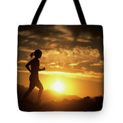 A Woman Jogs Under Sunset Tote Bag