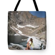 A Woman Looks Across A Partially Frozen Tote Bag