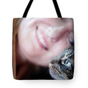 A Woman Lovingly Looking At Her Cat Tote Bag