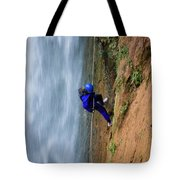 A Woman Rappelling Down Next To Deer Tote Bag