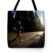 A Woman Running On A Country Road Tote Bag