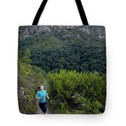 A Woman Running On One Of The Many Tote Bag
