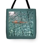 A Woman Swimming In A Pool Tote Bag