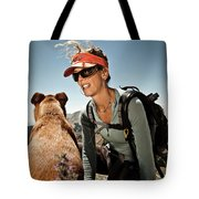 A Woman  Talks To Her Dog While Taking Tote Bag