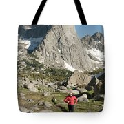 A Woman Trail Running In The Cirque Tote Bag