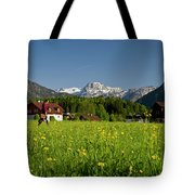A Woman Walks Through An Alpine Meadow Tote Bag