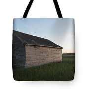 A Wooden Shed In The Middle Of A Grass Tote Bag