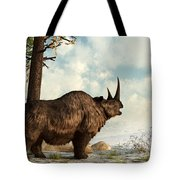 A Woolly Rhinoceros Trudges Tote Bag by Daniel Eskridge