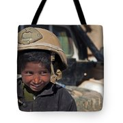 A Young Boy Wears A Coalition Force Tote Bag