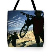 A Young Couple Carry Their Mountain Tote Bag