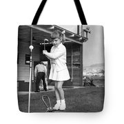 A Young Girl Hits A Golf Ball Tote Bag