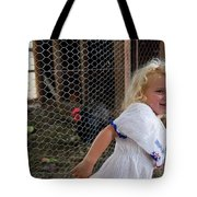 A Young Girl Shows Off Her Familys Tote Bag