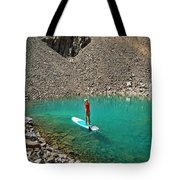 A Young Male Paddleboarding On A Small Tote Bag