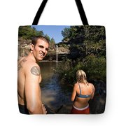 A Young Man And Woman Pause Tote Bag