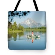 A Young Man Fly Fishes From His Drift Tote Bag