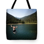 A Young Man Jumps From A Ledge Tote Bag