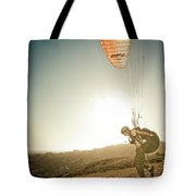 A Young Man Launches His Paraglider Tote Bag