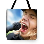 A Young Man Sings To A Microphone Tote Bag