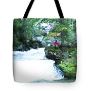 A Young Man Sits Peacefully Taking Tote Bag