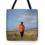 A Young Man Stands In A Field Tote Bag