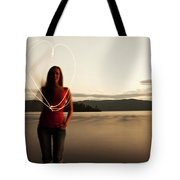 A Young Woman Drawing A Heart At Sunset Tote Bag