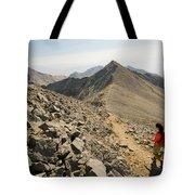 A Young Woman Hikes Borah Peak Tote Bag