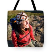 A Young Woman Hiking On Cadillac Tote Bag